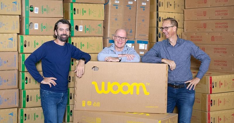 woom-Gründer Christian Bezdeka und Marcus Ihlenfeld sowie CEO Guido Dohm